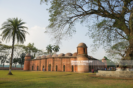 BAGERHAT, BANGLADESH - FEBRUARY 17, 2014: Unidentified people visit Shat Gombuj Mosque in Bagerhat, Bangladesh. Shat Gombuj Mosque is the UNESCO World Heritage site and the largest mosque in Bangladesh (Sixty Tomb Mosque). (Dmitry Chulov)
