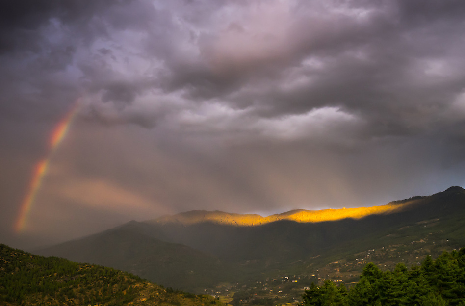 PARO, BHUTAN - CIRCA October 2014: Storm rolling into the mountains near Paro with rainbow (Daniel Korzeniewski)