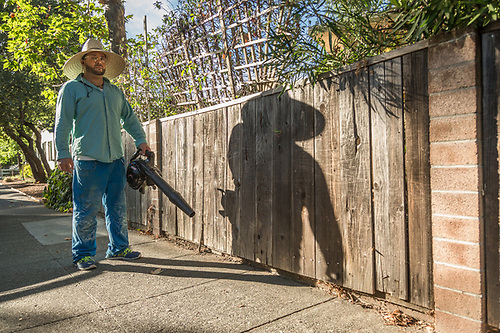 """I love what I do...I love who I am...I want to learn and share."" -Wine industry cellar worker and 19 year resident of Calistoga, Jose Pena cleans up around his home on Fair Way Street. (Clark James Mishler)"