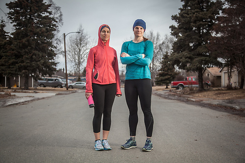Attorneys Carina Uraiqat and Meghan Kelly preparting to run near Inlet View Elementary School, Anchorage. (© Clark James Mishler)