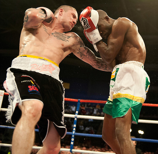 GLASGOW, SCOTLAND - MARCH 10: Ricky Burns of Scotland Paulus Moses of Namibia exchange blows during the WBO world lightweight title fight at the Braehead Arena on March 10, 2012 in Glasgow, Scotland. (Photo by Rob Casey/Getty Images) (Rob Casey/Getty Images)