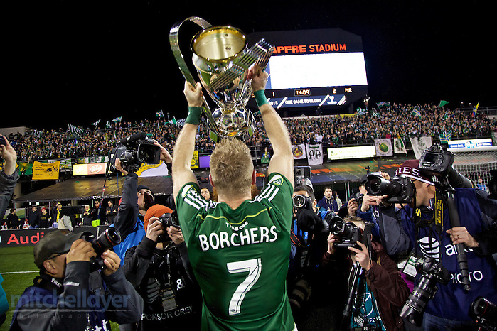 Dec 6, 2015; Columbus, OH, USA; Portland Timbers defender Nat Borchers (7) lifts the 2015 MLS Cup towards the Timbers Army after the match at MAPFRE Stadium. Photo: Craig Mitchelldyer-Portland Timbers (Craig Mitchelldyer, Craig Mitchelldyer)
