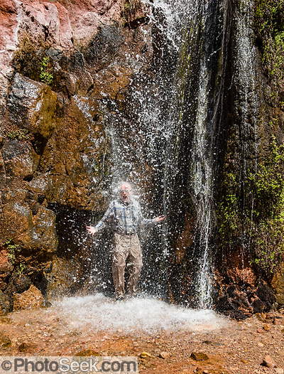 Tom showers in Stone Creek waterfall at Colorado River Mile 132.5 (measured downstream from Lees Ferry). Day 9 of 16 days rafting 226 miles down the Colorado River in Grand Canyon National Park, Arizona, USA. (© Tom Dempsey / PhotoSeek.com)