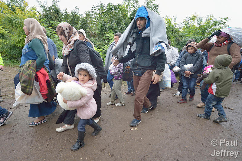 Refugees and migrants on their way to western Europe approach the border into Croatia near the Serbian village of Berkasovo. (Paul Jeffrey)
