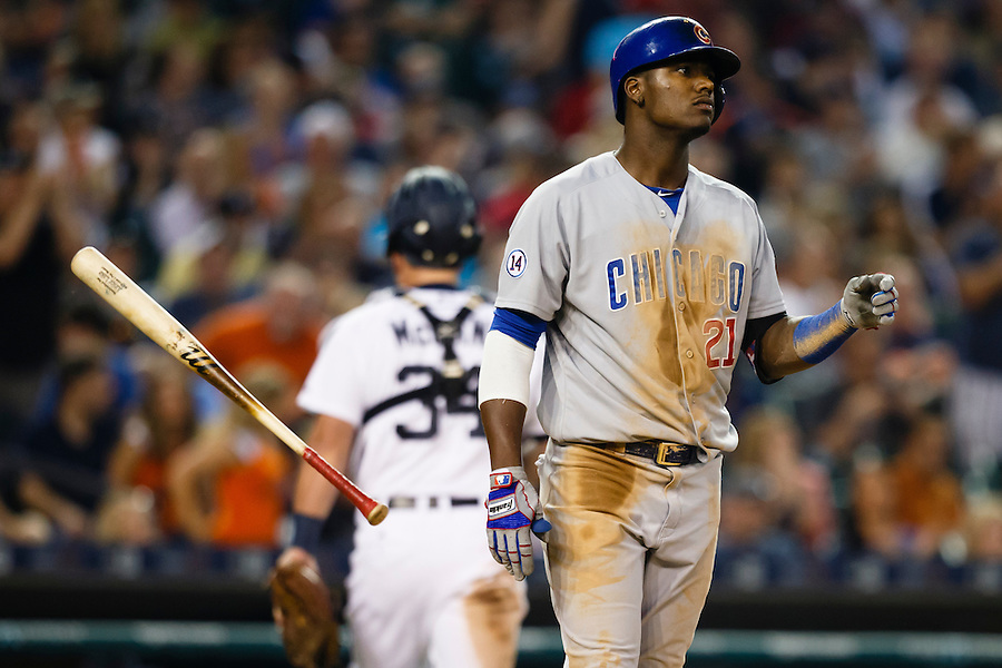 Jun 9, 2015; Detroit, MI, USA; Chicago Cubs right fielder Junior Lake (21) tosses his bat after striking out in the seventh inning against the Detroit Tigers at Comerica Park. Mandatory Credit: Rick Osentoski-USA TODAY Sports (Rick Osentoski/Rick Osentoski-USA TODAY Sports)