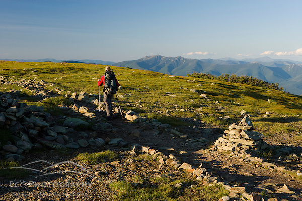 A hiker on the Appalachian Trail on the summit of Mount Moosilauke in New Hampshire's White Mountains.  Benton, New Hampshiire. (Jerry and Marcy Monkman)
