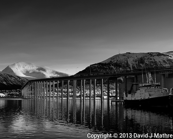 Tromsø, Norway bridge and reflection. Image taken with a Leica X2 camera (ISO 100, 24 mm, f/5.6, 1/100 sec). Raw image processed with Capture One Pro (including conversion to B&W). (David J Mathre)