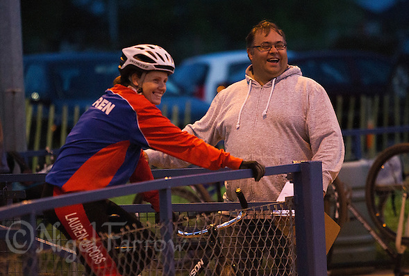 26 MAY 2015 - IPSWICH, GBR - Ipswich Cycle Speedway Club chairman Jamie Goldsmith (right) and Lauren Jacobs share a joke during a club championship night at Whitton Sports and Community Centre in Ipswich, Suffolk, Great Britain (PHOTO COPYRIGHT © 2015 NIGEL FARROW, ALL RIGHTS RESERVED) (NIGEL FARROW/COPYRIGHT © 2015 NIGEL FARROW : www.nigelfarrow.com)