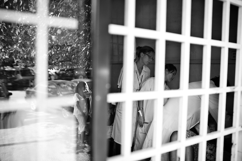 Doctors at Calmette Hospital check on victims who were injured in the stampede on November 22nd in Phnom Penh, Cambodia. (Quinn Ryan Mattingly)