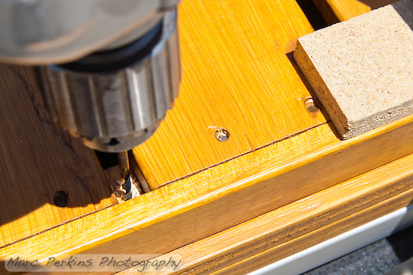 Drilling the pilot hole for the shelf attachment. (Marc Perkins)
