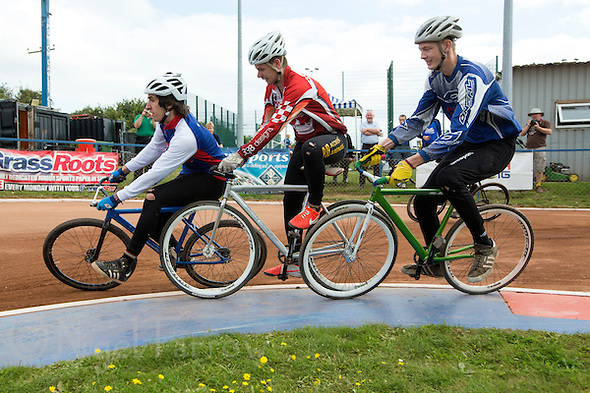 13 SEP 2014 - IPSWICH, GBR - Josh Brooke (left) from Ipswich leads Nathan Groves (centre) from Birmingham Monarchs and Olly Buxton (right) from Hethersett Hawks round the first bend during a second semi final heat at the 2014 British Open Club Cycle Speedway Championships at Whitton Sports & Community Centre in Ipswich, Great Britain (PHOTO COPYRIGHT © 2014 NIGEL FARROW, ALL RIGHTS RESERVED) (NIGEL FARROW/COPYRIGHT © 2014 NIGEL FARROW : www.nigelfarrow.com)