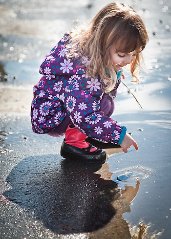 Adalyn Hatch, age 3, in her breakup boots during spring thaw, Anchorage, Alaska (Clark James Mishler)