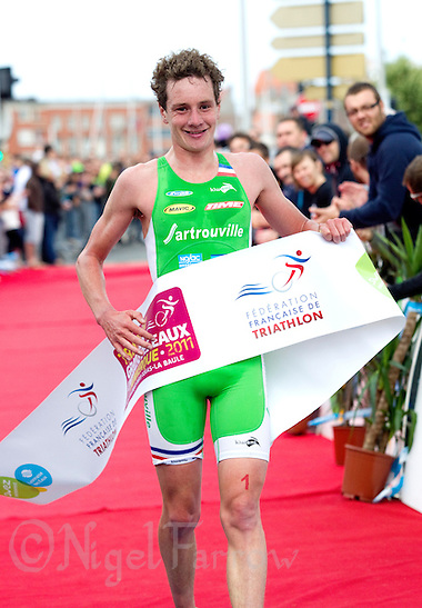 22 MAY 2011 - DUNKERQUE, FRA - Alistair Brownlee (EC Sartrouville) celebrates winning the men&#039;s round of the 2011 French Grand Prix triathlon series (PHOTO (C) NIGEL FARROW) (NIGEL FARROW/(C) 2011 NIGEL FARROW)