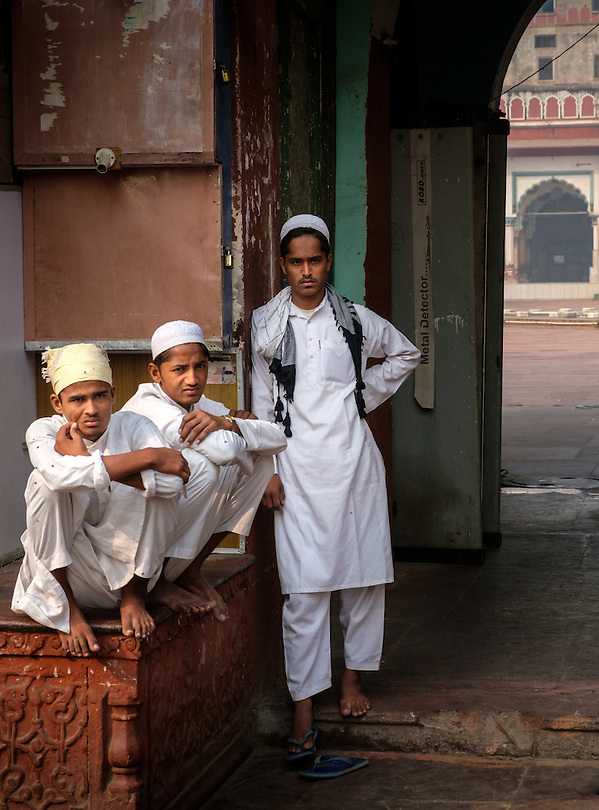 NEW DELHI, INDIA - CIRCA OCTOBER 2016: Young muslim boys standing at the Fatehpuri Masjid in Old Delhi. The mosque located at the western end of the oldest street of Delhi, Chandni Chowk. (Daniel Korzeniewski)