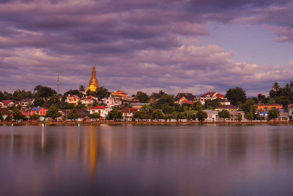KYAING TONG, MYANMAR - CIRCA DECEMBER 2017: View of lake Nong Tung and Wat Noi Naw in Kyaing Tong at sunset. (Daniel Korzeniewski)