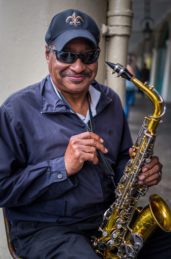 NEW ORLEANS - CIRCA FEBRUARY 2014: Street musician performing in the streets of famous French Quarter in New Orleans (Daniel Korzeniewski)