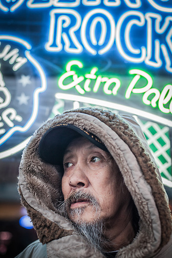 "Retired commercial fisherman, Raymond Trigg in front of the Panhandle Bar on Fourth Avenue in downtown Anchorage.  Mr Trigg was born in Nome but grew up in Seward where he lives in the summer.  ""I come to Anchorage each winter to play"".  ℅ Panhanle Bar, 312 W. 4th Ave. 99501 (© Clark James Mishler)"