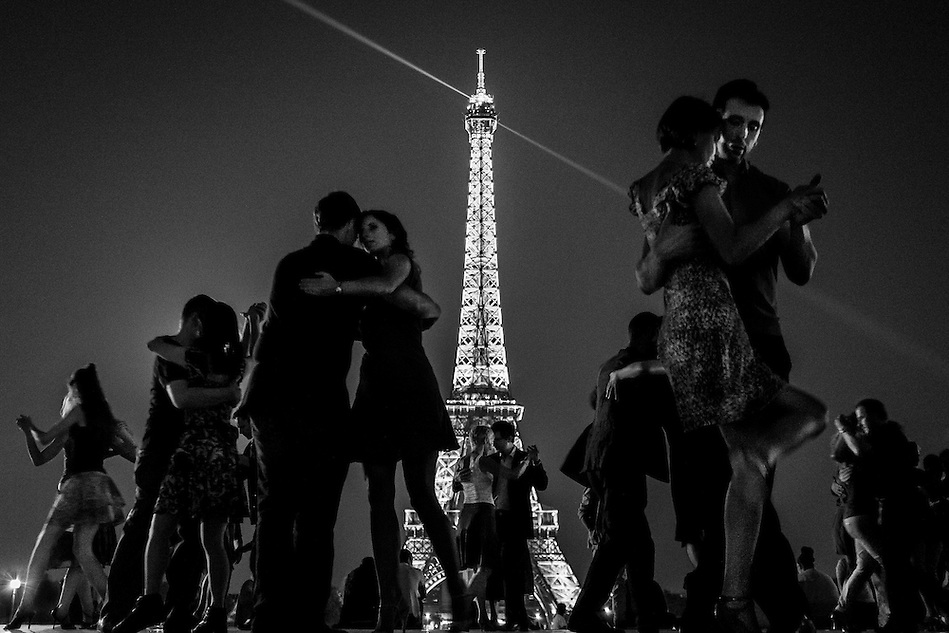 Parisians and tourists tango on the Trocadero Esplanade across from the Eiffel Tower in Paris, France. (Pete Marovich/Pete Marovich Images)