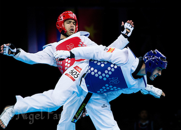 10 AUG 2012 - LONDON, GBR - Yousef Karami (IRI) (left) of Iran and Nicolas Garcia Hemme (ESP) (right) of Spain trade kicks during their men's -80kg category preliminary round contest at the London 2012 Olympic Games Taekwondo at Excel in London, Great Britain .(PHOTO (C) 2012 NIGEL FARROW) (NIGEL FARROW/(C) 2012 NIGEL FARROW)