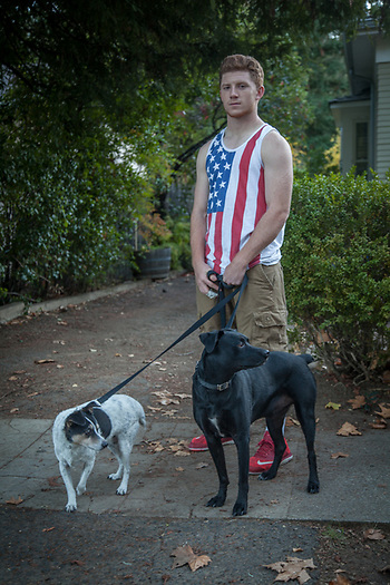 "High school senior Dustin Anderson with his dogs Bodhi and Cyan in Calistoga, CA  ""I'm on the football team and our last game was this week...I dislocated one of my fingers.""  ""Why the American flag?""  ""I wanted to wear it today...patriatism, I guess.""  dustin.anderson1473@gmail.com (© Clark James Mishler)"