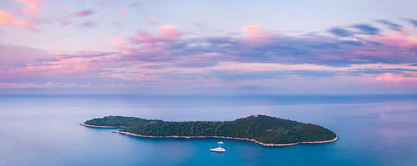 Panoramic photo of Lokrum Island at sunrise, Dubrovnik, Dalmatian Coast, Croatia, Europe. This panoramic photo, taken at sunrise from Zarkovica Hill, shows Lokrum Island on the Dalmatian Coast, located just a few hundred metres from Dubrovnik in Croatia. Lokrum Island is one of hundreds of small islands that lie in the Adriatic Sea, along the Dalmatian Coast.
