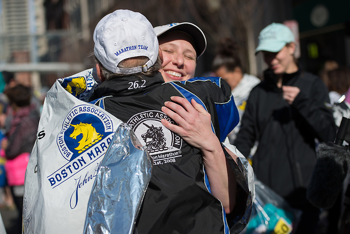 4/18/16 – Boston, MA – A Tufts Marathon Team runner Stacey Lancaster hugs Coach Donald Megerle after the finish of the 2016 Boston Marathon on April 18, 2016. (Sofie Hecht / The Tufts Daily) (Sofie Hecht / The Tufts Daily)