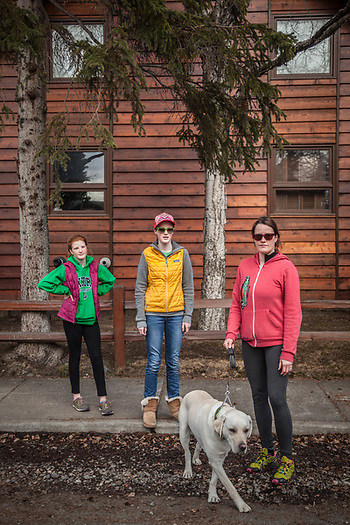 Beth Kemp with her daughters Maya (13) and Ani (11) and her dog, Sam, near their home in Anchorage's South Addition neighborhood  beth.kemp@gmail.com (© Clark James Mishler)
