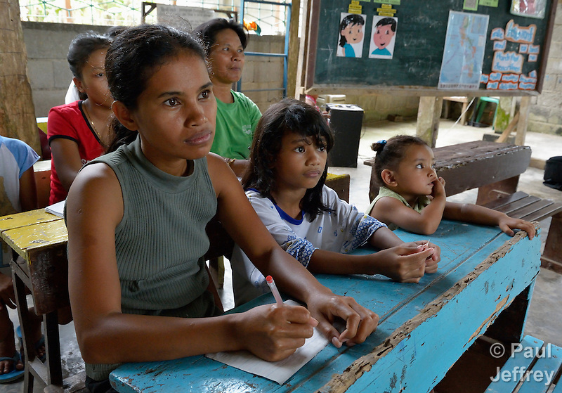 Girls and women in a literacy class in the village of Inopawan, in New Bataan in the Compostela Valley on Mindanao Island in the southern Philippines. (Paul Jeffrey)