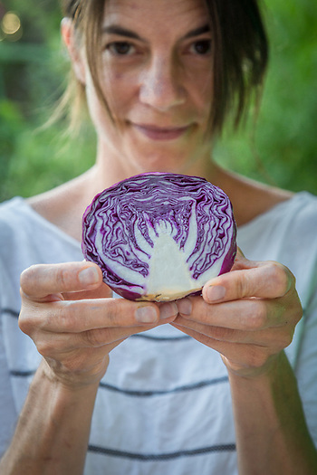 """I just cut this cabbage...it reminds me of a dancing woman.""  Artist, educator and neigbor Anna Johansson in front of her home on Cedar Street in Calistoga (Clark James Mishler)"