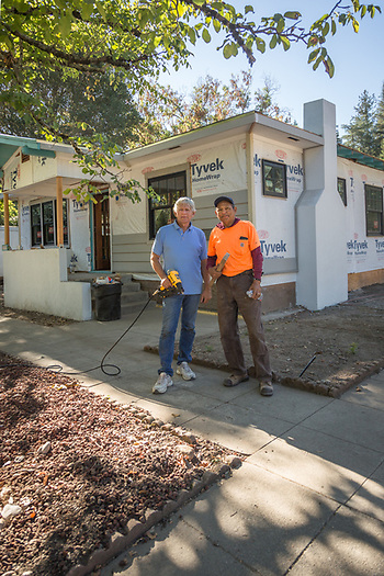 Jack with his construction assistant, Daniel Salgado, stand in front of his duplex remodel project on Myrtle Street in Calistoga (Clark James Mishler)
