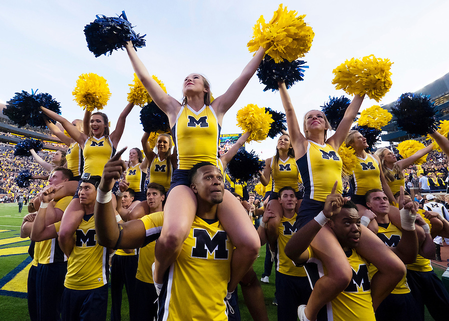 Oct 10, 2015; Ann Arbor, MI, USA; Michigan Wolverines cheerleader celebrate after the game against the Northwestern Wildcats at Michigan Stadium. Michigan won 38-0. Mandatory Credit: Rick Osentoski-USA TODAY Sports (Rick Osentoski/Rick Osentoski-USA TODAY Sports)