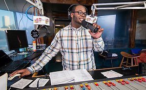 "North Forest High School senior Joseph Vaughns hosts his show ""Generation Next"" at the KCOH studio, September 20, 2014. (Dave Einsel / Houston ISD)"