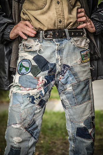 Carefully mended jeans as worn by Anchorage radio personality Steve Heimel (© Clark James Mishler)