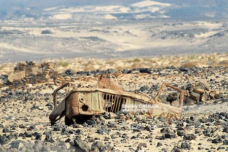 CIRCA ADEN, YEMEN - SEPTEMBER 14, 2006: Remains of a cabin of a Soviet truck GAZ-66 stay at the former mine field near Aden, Yemen. (Dmitry Chulov)