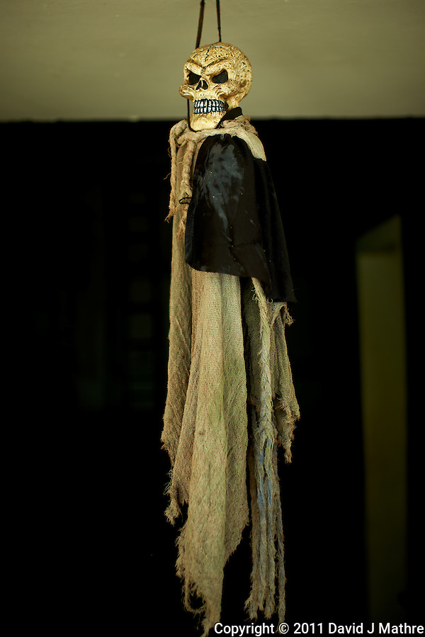 Hanging Skeleton Doll. Museum of Traditions and Legends in Leon, Nicaragua. Image taken with a Nikon D3x and 35 mm f/1.4 lens (ISO 140, 35 mm, f/2, 1/160 sec). Raw image processed with Capture One Pro, Focus Magic, Nik Define, and Photoshop CS5. (David J Mathre)