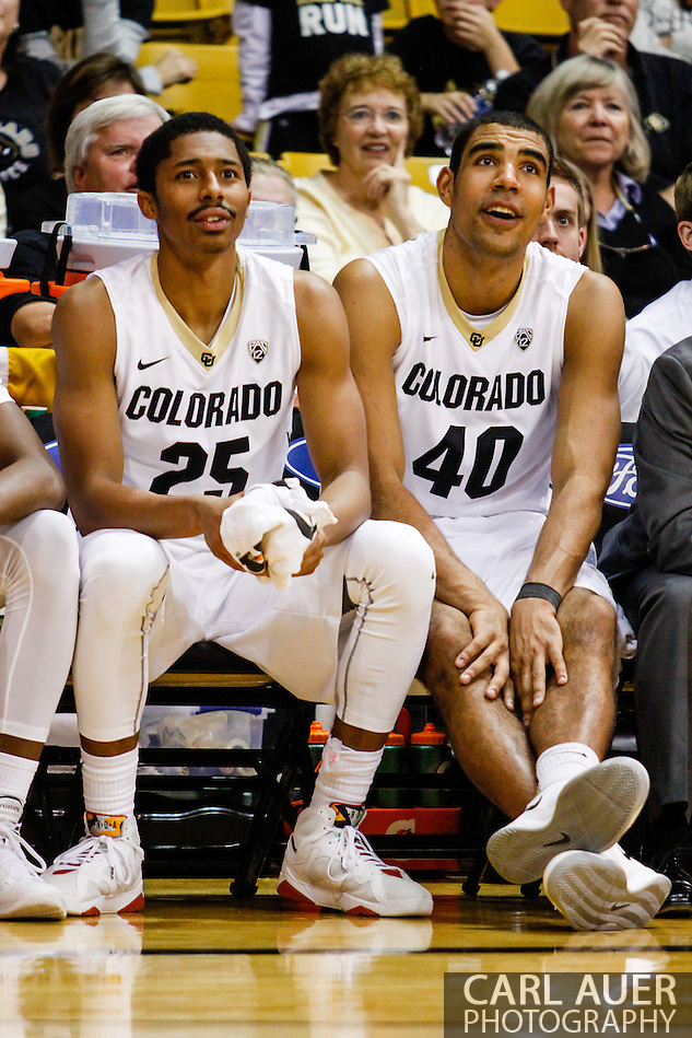 November 16th, 2013:  Colorado Buffaloes junior guard Spencer Dinwiddie (25) and sophomore forward Josh Scott (40) watch the reserves play in the second half of action in the NCAA Basketball game between the Jackson State Tigers and the University of Colorado Buffaloes at the Coors Events Center in Boulder, Colorado (Carl Auer/ZUMAPRESS.com)