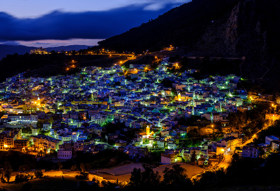 CHEFCHAOUEN, MOROCCO - CIRCA APRIL 2017: Blue hour in Chefchaouen as seen from a hilltop. This is a popular tourist destination in Morocco (Daniel Korzeniewski)