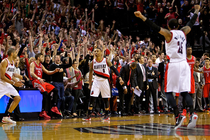 May 2, 2014; Portland, OR, USA; Portland Trail Blazers guard Damian Lillard (0) reacts after hitting the game winning shot against the Houston Rockets during the fourth quarter in game six of the first round of the 2014 NBA Playoffs at the Moda Center. Mandatory Credit: Craig Mitchelldyer-USA TODAY Sports (Craig Mitchelldyer/Craig Mitchelldyer-USA TODAY Sports)