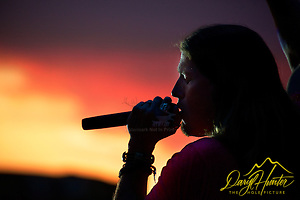 "Jason Michael Carroll sings into a Napoli sunset at a Concert in Naples Italy (© Daryl Hunter's ""The Hole Picture""/Daryl L. Hunter)"