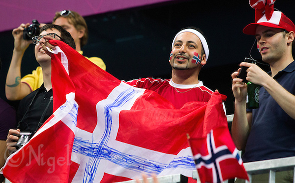 11 AUG 2012 - LONDON, GBR - A Danish supporter uses a bit of ingenuity by inking the additional blue cross onto a Danish flag as he  supports Norway in the women's London 2012 Olympic Games handball final against Montenegro  in the Basketball Arena in Olympic Park, in Stratford, London, Great Britain .(PHOTO (C) 2012 NIGEL FARROW) (NIGEL FARROW/(C) 2012 NIGEL FARROW)