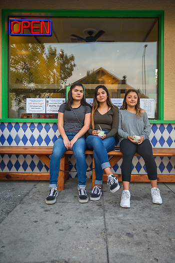 Saint Helena high school students Angelica Rameriz, Arlen Robledo and Yuleni Sanchez drove up to Calistoga for ice cream after the end of the evacuation order. (Clark James Mishler)