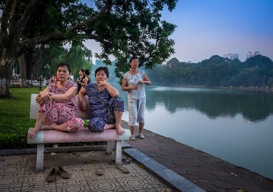 HANOI, VIETNAM - CIRCA SEPTEMBER 2014:  Vietnamese woman early morning in the Hoan Kiem Lake, in Hanoi. (Daniel Korzeniewski)