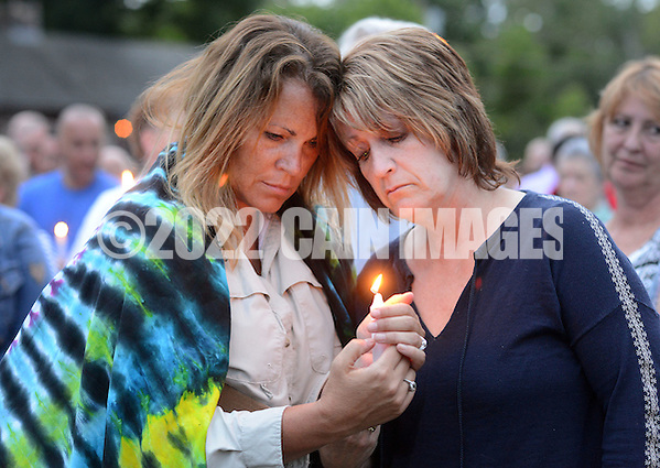 Christine Martucci, left, and Barbara Young-Martucci of Frenchtown, New Jersey reflect as names of victims are read during a candlelight vigil in support of the victims of the Orlando massacre Monday, June 13, 2016 in New Hope, Pennsylvania. (Photo by William Thomas Cain) (William Thomas Cain)