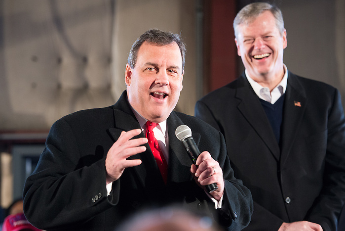 Republican presidential candidate and N.J. governor CHRIS CHRISTIE speaks at a rally in Bedford, N.H. to encourage primary voters to vote for him on Tuesday. Behind him stands Mass. governor CHARLIE BAKER, CHRISTIE's most recent major endorsement. (Evan Sayles / The Tufts Daily)