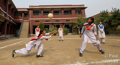 Students play volleyball at the Lucie Harrison Girls High School in Lahore, run by the Church of Pakistan.