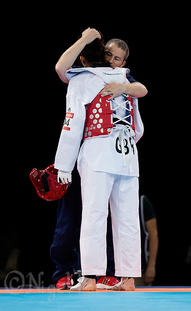 10 AUG 2012 - LONDON, GBR - Sarah Stevenson (GBR) (left) of Great Britain is comforted by her husband and coach Steve Jennings (right) after her women's -67kg category preliminary round contest defeat to Paige McPherson during the London 2012 Olympic Games Taekwondo at Excel in London, Great Britain .(PHOTO (C) 2012 NIGEL FARROW) (NIGEL FARROW/(C) 2012 NIGEL FARROW)
