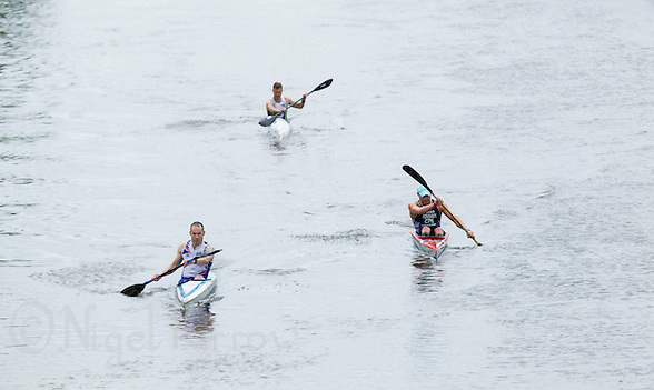 25 MAY 2014 - BRIGG, GBR - Mat Stephenson (GBR) (left) of Great Britain leads countryman Steve Clark (GBR) (back) and Leos Rousavy (CZE) of the Czech Republic in the kayak during the World Quadrathlon Federation 2014 Middle Distance World Championships at the Brigg Bomber in Brigg in Lincolnshire, Great Britain (PHOTO COPYRIGHT © 2014 NIGEL FARROW, ALL RIGHTS RESERVED) (NIGEL FARROW/COPYRIGHT © 2014 NIGEL FARROW : www.nigelfarrow.com)