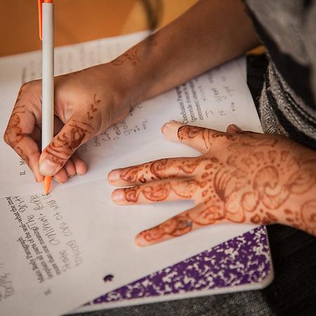 Young girl with henha tattos at the Rec Plus Homework Club at Irvington Terrace, Fremont, CA, Bridge Housing (© Clark James Mishler)