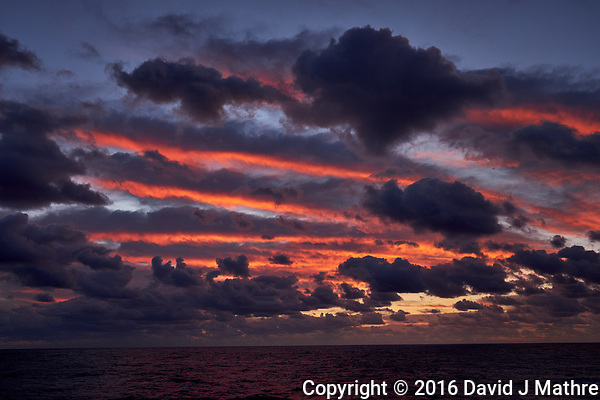 Colorful Dawn clouds over the Pacific Ocean from the deck of the MV World Odyssey. Image 2 of 6 taken with a Fuji X-T1 camera and 23 mm f/1.4 lens (ISO 200, 23 mm, f/5.6, 1/60 sec). Raw images processed with Capture One Pro. (David J Mathre)