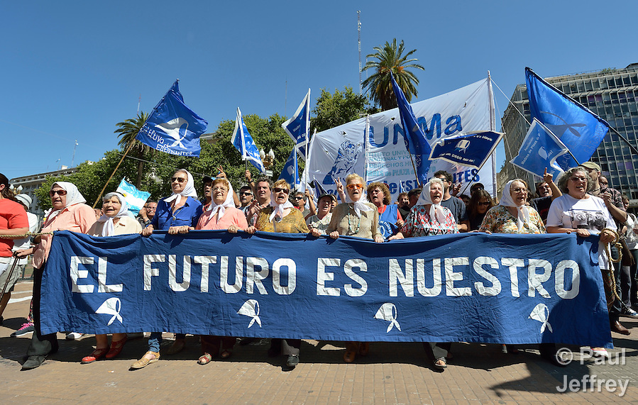 Within hours of President Mauricio Macri being sworn in as Argentina's new president on December 10, 2015, the Mothers of the Plaza de Mayo took to the Plaza in Buenos Aires to reiterate their demands for justice. The Mothers of the Plaza de Mayo joined together 38 years ago to demand information on what happened to their disappeared children during Argentina's Dirty War. (Paul Jeffrey)